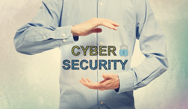 Young man in blue shirt displaying Cyber Security concept